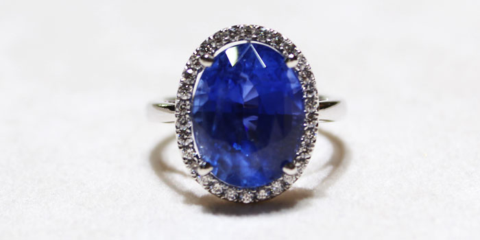 8.07 carat Oval Blue Sapphire with Pave Halo Diamonds Setting 18K White Gold Ring